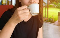 Female hand holding a cup of coffee Stock Images