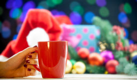 Female hand holding cup of coffee or tea Stock Images