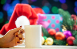 Female hand holding cup of coffee or tea Stock Photography