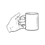 Female hand holding a cup with hot beverage Royalty Free Stock Images