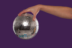 Female hand holding a disco ball Stock Images