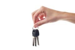 Female hand holding door key Royalty Free Stock Photo