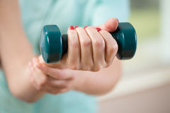 Female hand holding dumbbell Stock Photography