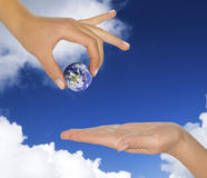 Female hand holding earth. Stock Photo