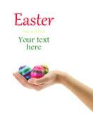 Female hand holding Easter eggs Stock Images