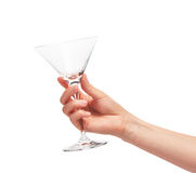 Female hand holding empty clean martini glass against white Stock Images