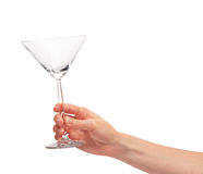 Female hand holding empty clean transparent martini glass Stock Images
