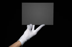 Female hand holding grey board Royalty Free Stock Photography