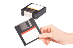 Female hand holding floppy disk Stock Photo