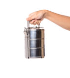 Female Hand Holding Food Container II. Female hand holding a stainless steel food container over white background Stock Images
