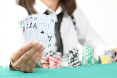 Female hand holding four aces Royalty Free Stock Photo