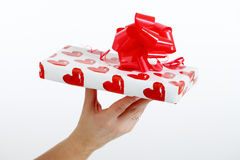 Female hand holding a gift Stock Photo