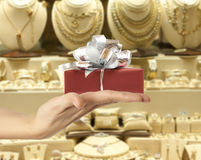 Female hand holding a gift Stock Photos
