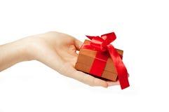 Female hand holding gift box Stock Photo