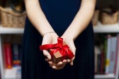 Female hand holding gift box Stock Photos