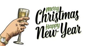 Female hand holding a glass with champagne. Cheers toast lettering. Female hand holding a glass with champagne. Merry Christmas Happy New Year lettering Royalty Free Stock Photos