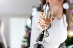 Female hand holding glass of champagne Royalty Free Stock Image
