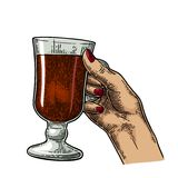 Female hand holding a glass of cocktail, wine, champagne. Royalty Free Stock Images