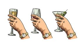 Female hand holding a glass of cocktail, wine, champagne. Stock Image
