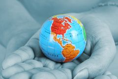 Female hand holding a globe Royalty Free Stock Image