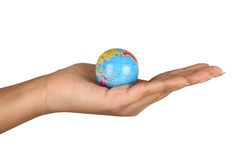 Female hand holding a globe Stock Photo