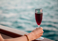 Female hand holding a goblet with red wine Stock Photo