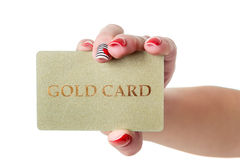 Female hand holding gold credit card isolated Stock Photos