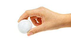 Female hand holding golf ball Stock Images