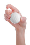 Female hand holding golf ball isolated on white Royalty Free Stock Photography