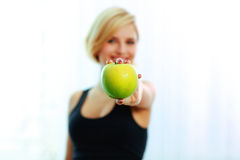 Female hand holding green apple Stock Photo
