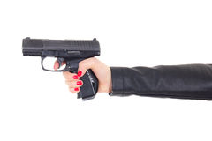 Female hand holding gun isolated on white Stock Images