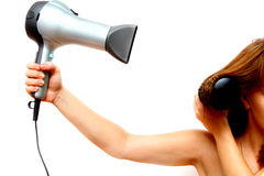 Female hand holding hairdryer. Over white background Royalty Free Stock Photography