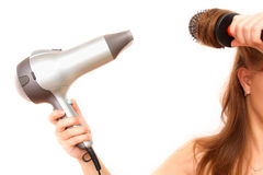 Female hand holding hairdryer. Over white background Royalty Free Stock Image