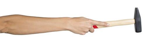 Female hand holding hammer Stock Image