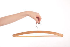 Female hand holding a hanger Royalty Free Stock Photography
