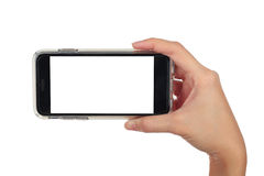 Female hand holding horizontal smart phone, use clipping path Stock Photos