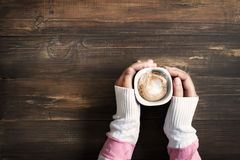 female hand holding hot cup of coffee stock photos