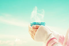 female hand holding hot cup of coffee royalty free stock images