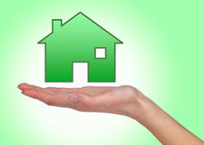 Illustrated house on female hand Royalty Free Stock Photos