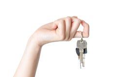 Female hand holding a key isolated Stock Photo