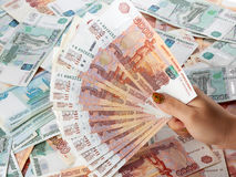Female hand holding a large amount of russian money rouble. Stock Photography