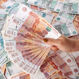 Female hand holding a large amount of russian money rouble. Stock Images