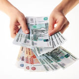 Female hand holding a large amount of russian money rouble. royalty free stock photography