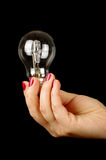 Female hand holding light bulb Royalty Free Stock Photography