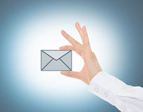 Female hand holding a mail icon Stock Photo