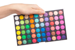Female hand holding a makeup palette Stock Photo