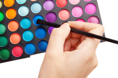Female hand holding a makeup palette Stock Images