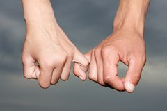 Female hand holding male hand on background stock photo