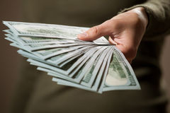 Female hand holding many dollar's banknotes Stock Images