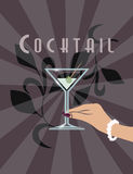 Female hand holding Martini cocktail royalty free stock photo